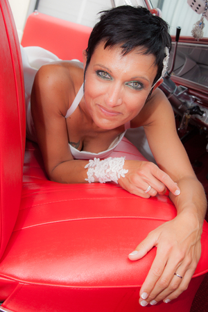 Bride in a vintage car photo