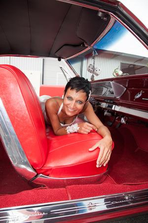 Bride in a vintage car photo