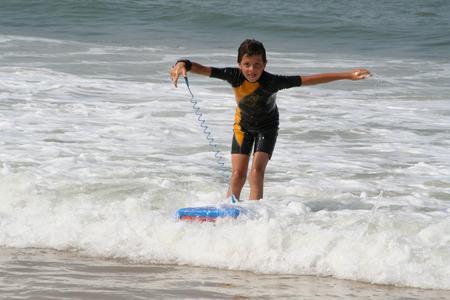 Little boy surfing photo