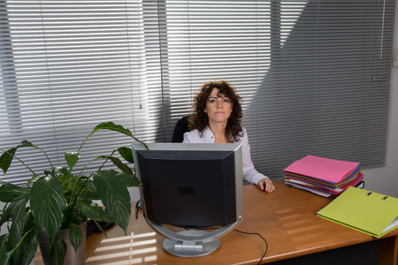 front desk: Front view of a woman secretary at his desk