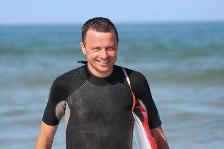 bodyboarding: Bodyboarding surfing man good looking standing with bodyboard surfboard