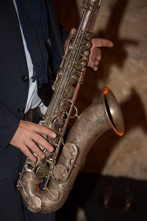 gig: Musician playing alto saxophone on a gig