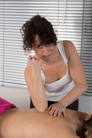 physiotherapist: Female physiotherapist massaging woman Stock Photo