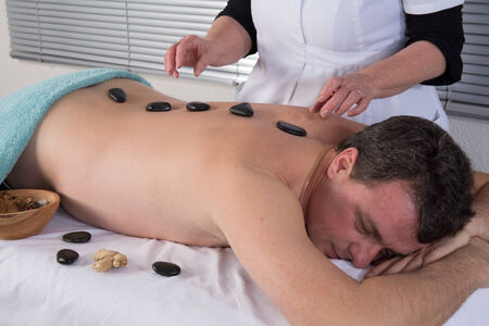 stone therapy: Man getting stone therapy massage in  spa