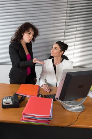 business disagreement: Two business woman having disagreement