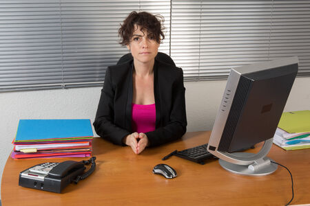 resolute: A resolute business woman at work Stock Photo