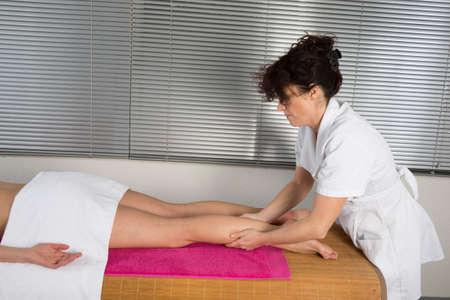 acupressure hands: A woman receiving a ayurvedic massage on her legs