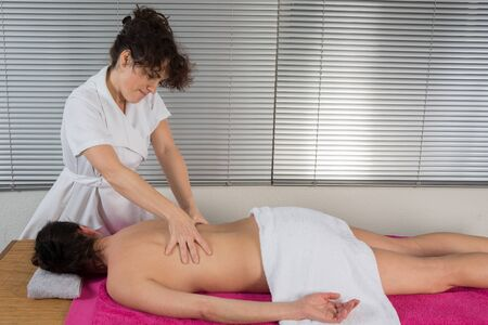 getting: Beautiful Woman Getting Spa Treatment. Massage