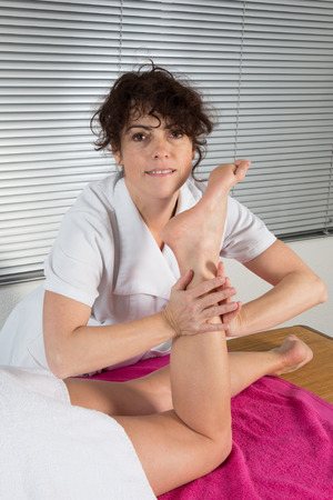 traditional healer: Woman getting a foot massage