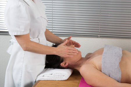 spirit healer: A woman spirit healer doing reiki treatment to a woman