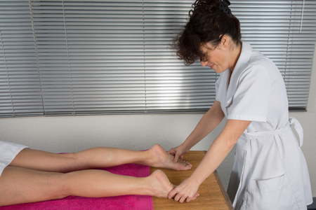 traditional healer: Foot massage in the spa salon
