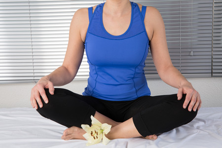 young woman meditating in pose of lotus. Yoga background photo