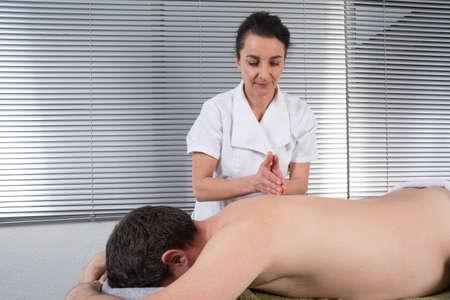 A man receiving a back massage photo