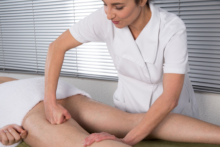 traditional healer: Chinese Treatment with massaging on the legs and feet