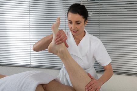revitalize: Foot massage in the spa salon