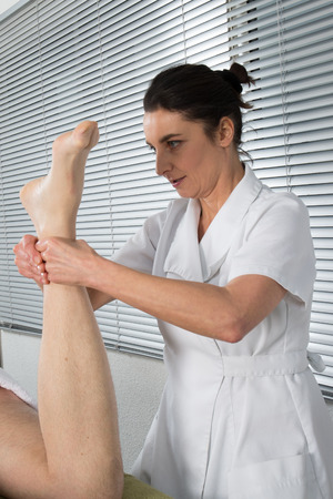 acupressure hands: Foot treatment by a foot therapist a Spa center