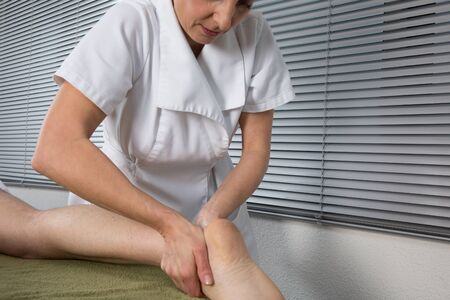 tuina: Chinese massage on mans feet