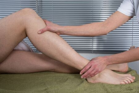 easing: Man is getting a massage on his body