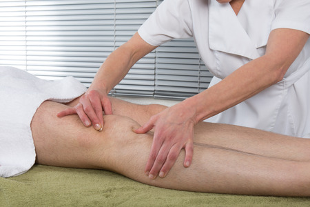 alternative wellness: Man is getting a massage on his body