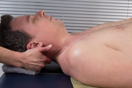 spirit healer: A woman spirit healer doing reiki treatment to a man