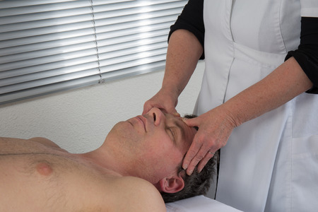 acupressure: A therapist using acupressure to cure a man