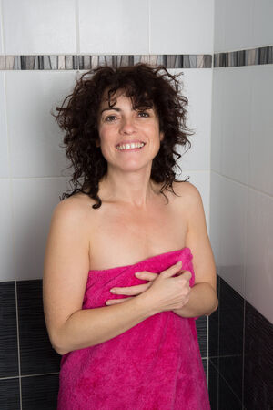 women s health: Woman washing her body under the shower