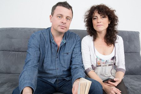 middle aged couple: Middle aged couple relaxing in sofa at home Stock Photo