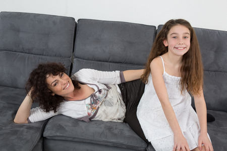 A daughter and her mum together to relax after work