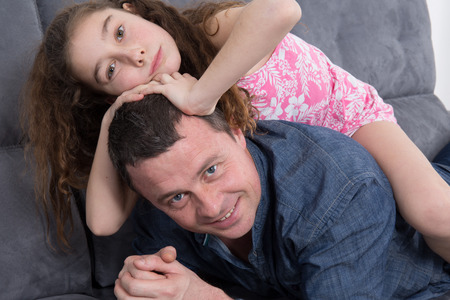 accomplices: Portrait of a father and his daughter