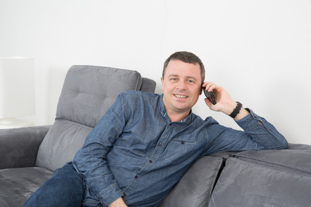 phonecall: Portrait of cheerful man talking on the phone