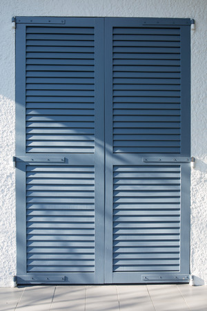 The background of straps blue imitating wooden shutters Standard-Bild