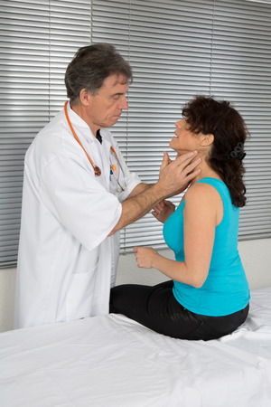 doctor endocrinologist testing woman patient at office