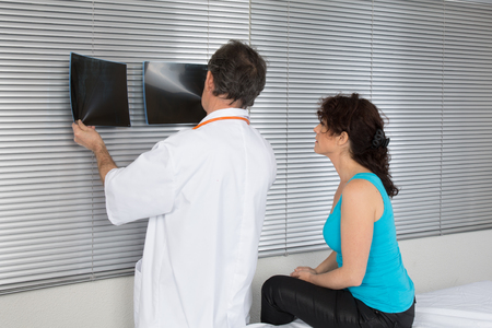 hospital patient: doctor showing the results to his patient in the hospital