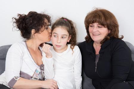 three generations of women: Three happy generations of women on a sofa Stock Photo