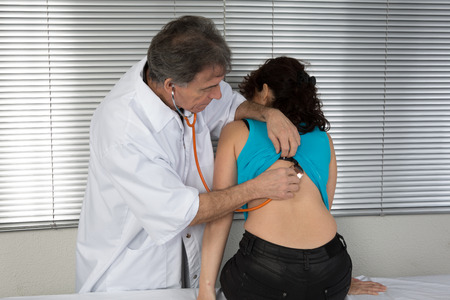 auscultation: Doctor examining a male patient in His medical room