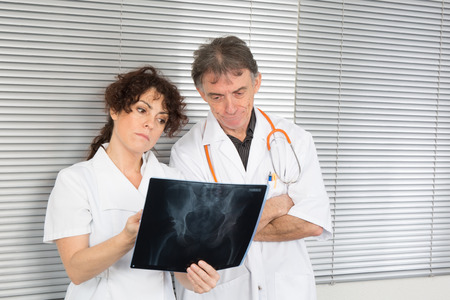 Two doctors looking at x-ray . photo