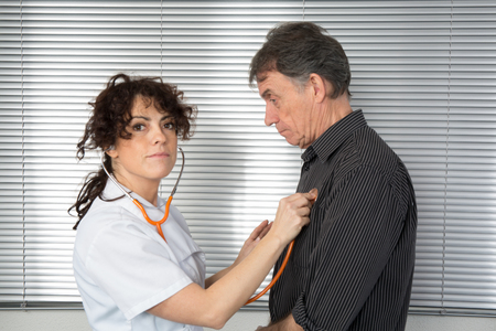 Doctor talking to a male patient holding a stethoscope