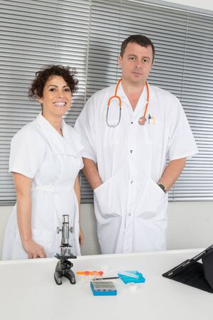 Two smiling doctors are looking at the camera photo