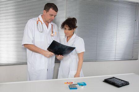 Two Doctors looking at x-ray at hospital photo