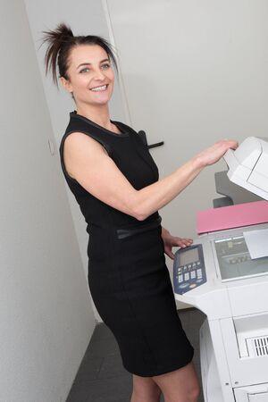 copy machine: secretary using a copy machine
