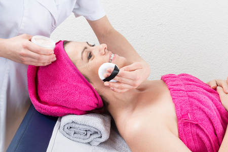 esthetician: Make up artist doing professional make up of a woman