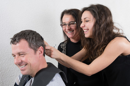 trainees: Hairdressing and trainees learning the barber profession Stock Photo