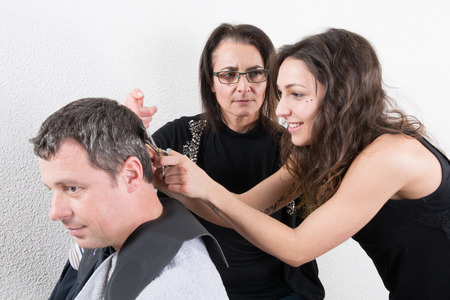 Hairdressing and trainees learning the barber profession photo