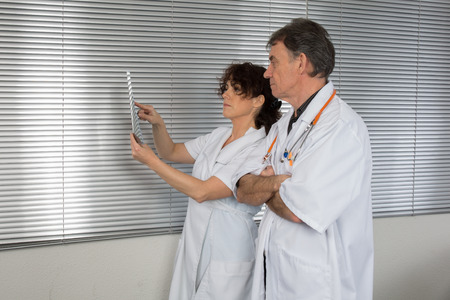 Two doctors looking at x-ray. photo