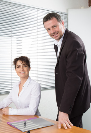 A Happy successful business team or partners with a smiling man and woman photo