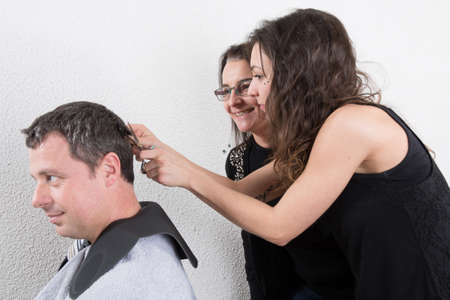 haircurlers: Hairdressing and trainees learning the barber profession Stock Photo