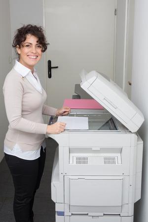 xerox: secretary using a copy machine