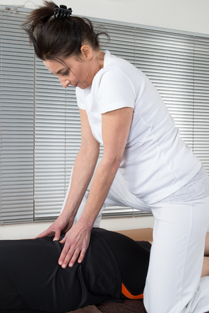 two women and one man: One man and woman performing back  massage