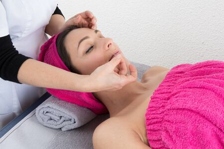 getting: Woman lying on massage table getting acupuncture