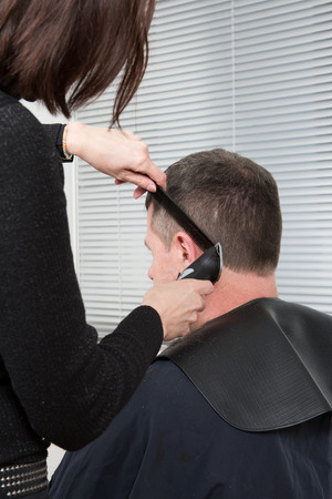 electric razor: Hairdresser cuts hair with a electric razor